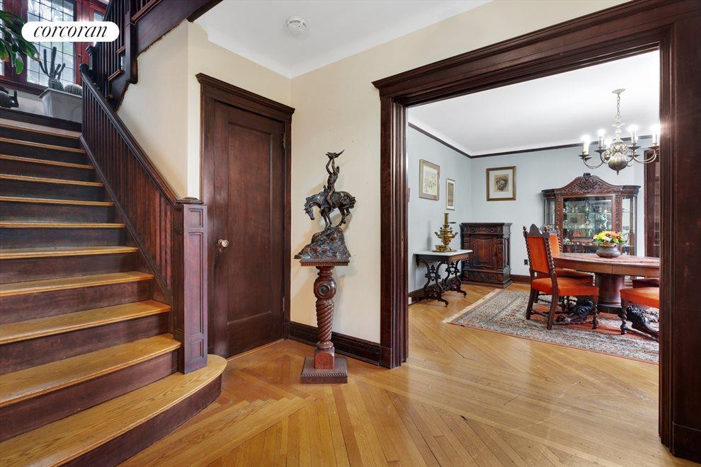 Entry Foyer w/ Original Staircase & Woodwork