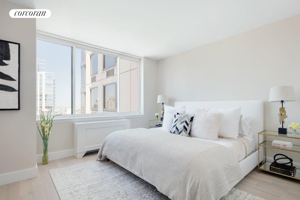 New York City Real Estate | View 389 East 89th Street, #28A | Master Bedroom w/ city views