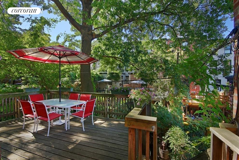 Private rear deck leads to shared garden