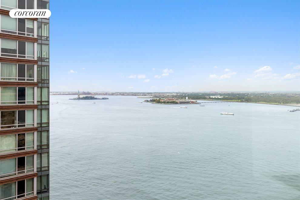 New York City Real Estate | View 30 West Street, #27E | View SW of Hudson River and Statue of Liberty