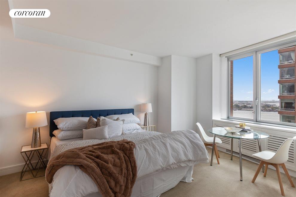 New York City Real Estate | View 30 West Street, #27E | Master Bedroom with River Views