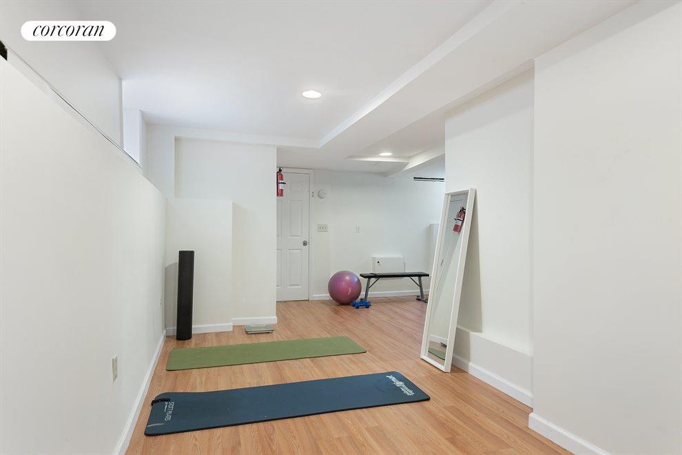 Finished basement w/ 1.5 baths has flexible use