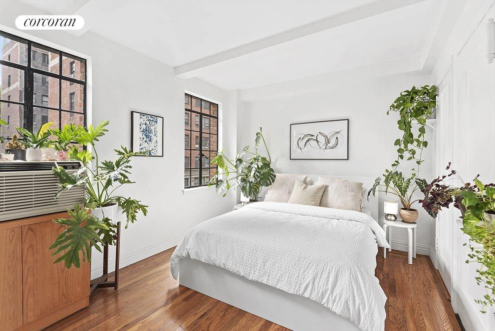 Bright and airy bedroom with lovely garden views