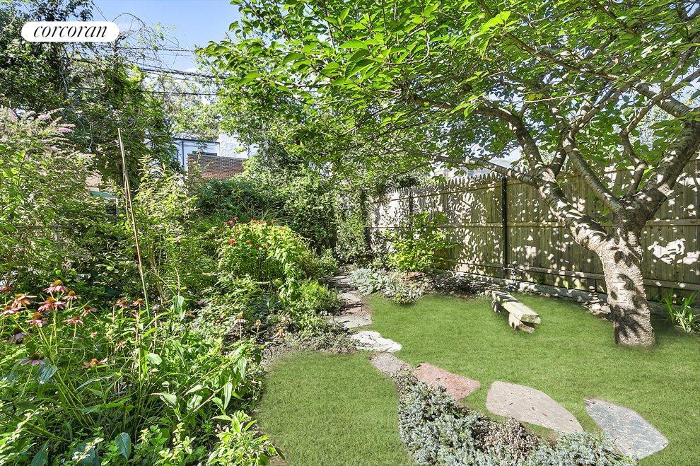 Beautifully curated garden: ornament & medicinals.