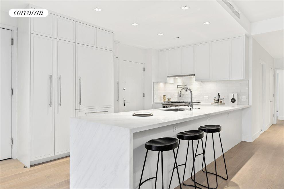 honed marble counters & custom cabinetry