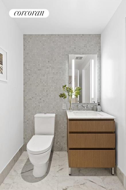 Third Bathroom with marble tile and feature wall