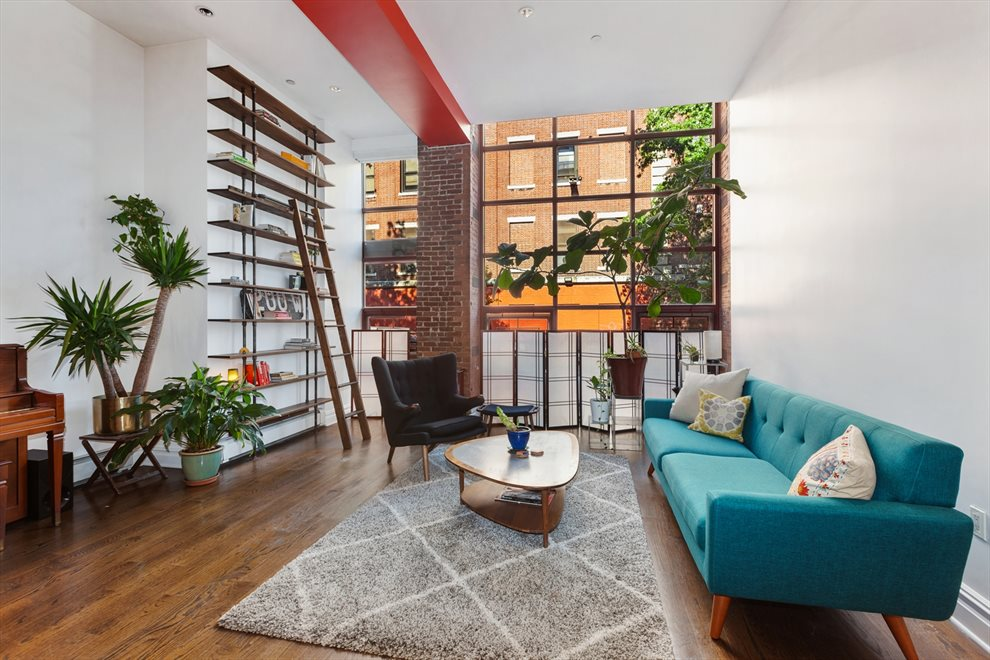 a grand loft feeling with 14' Ceilings