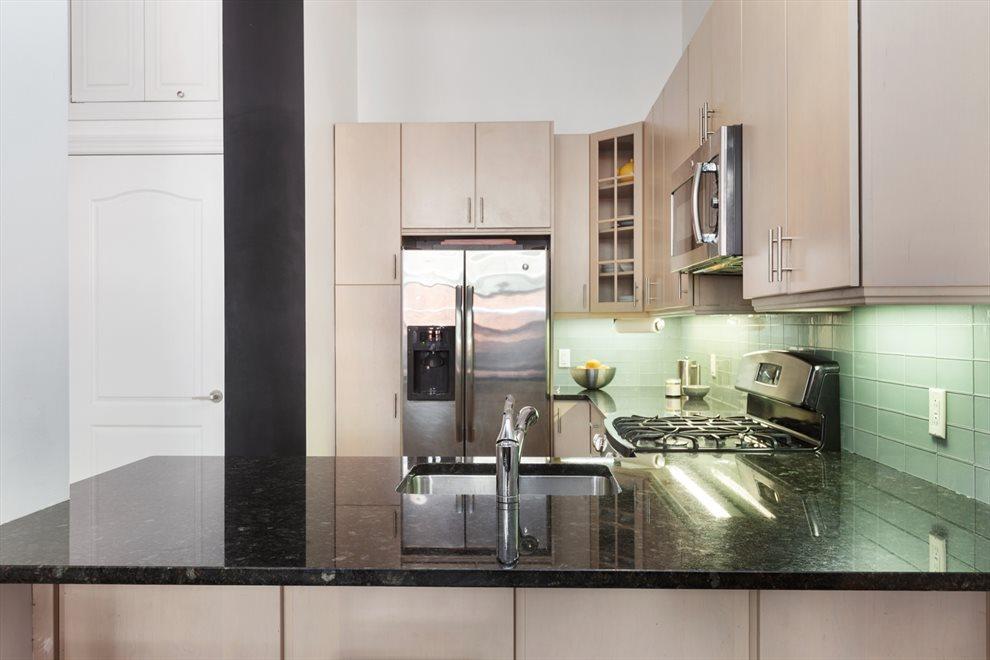 Stainless steel appliances &  large breakfast bar