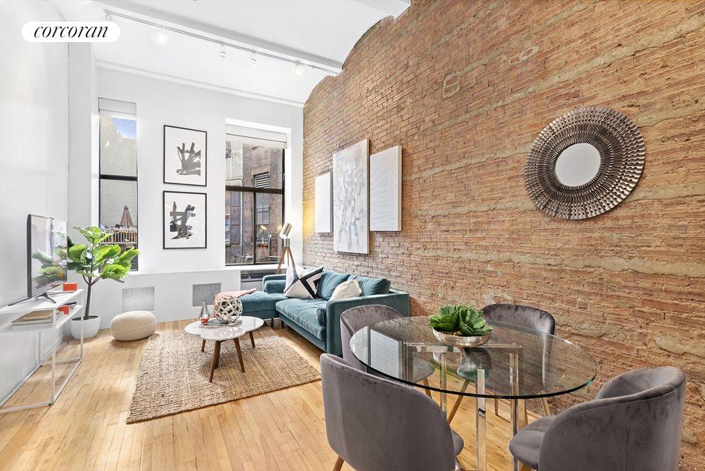 High ceilings, exposed brick & over-sized windows!