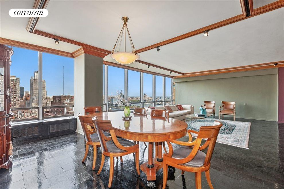 Dining in Living Room With Open Sky & River Views
