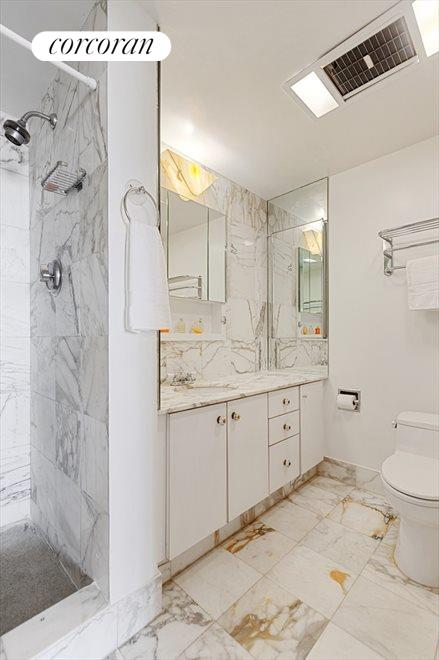 Marble Bathrooms with Updated Fixtures