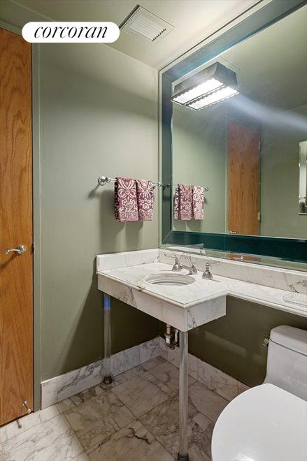 Lower Level Powder Room With Marble Counters
