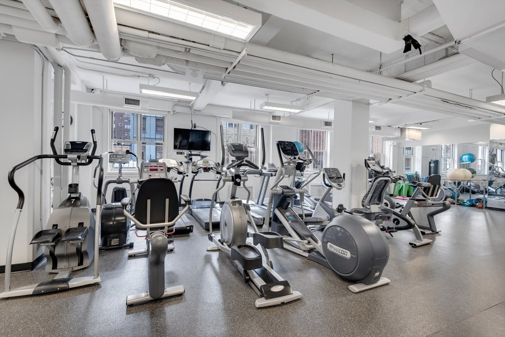 Gym with cardio and weight equipment
