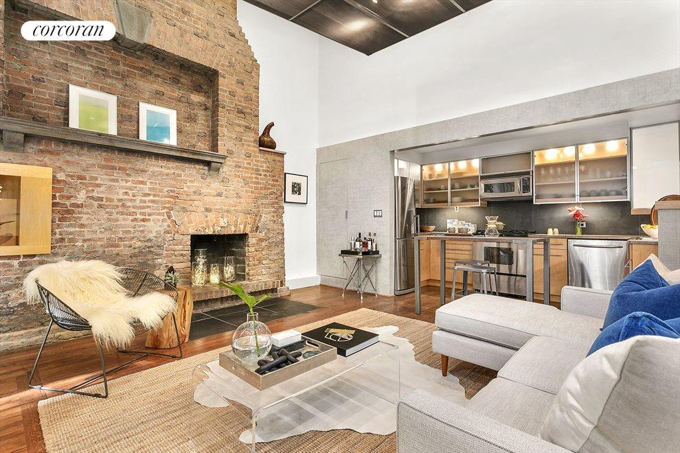 New York City Real Estate | View 131 West 11th Street, #2 | Living Room + Wood-Burning Fireplace