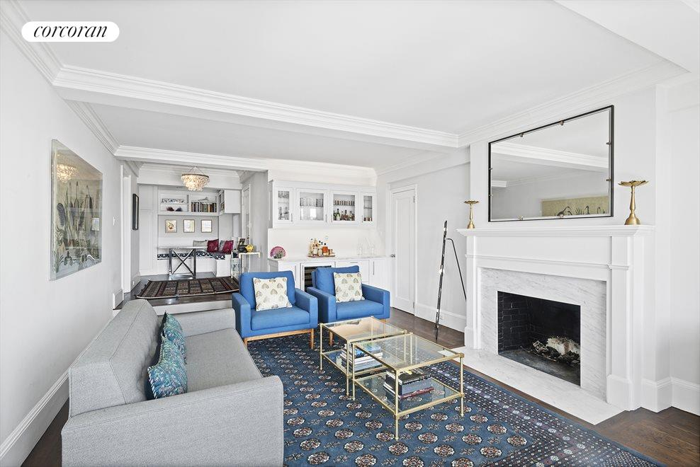 Living Room with Beamed Ceiling and Fireplace