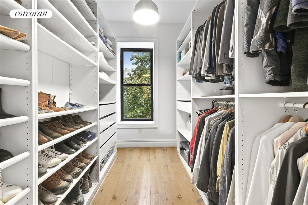 This bedroom is being used as a walk-in closet!