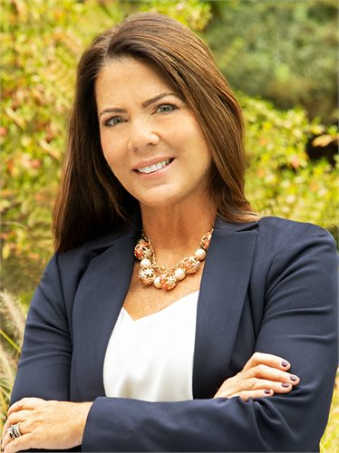Kelly Becker, a top realtor in The Hamptons for Corcoran, a real estate firm in Westhampton Beach.