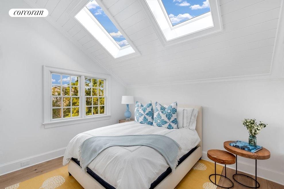 Ensuite guest bedroom with skylights