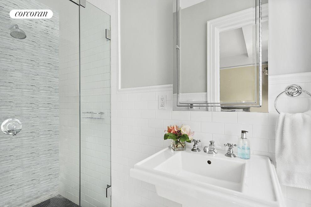 Classic Details Hit the Mark in Renovated Baths