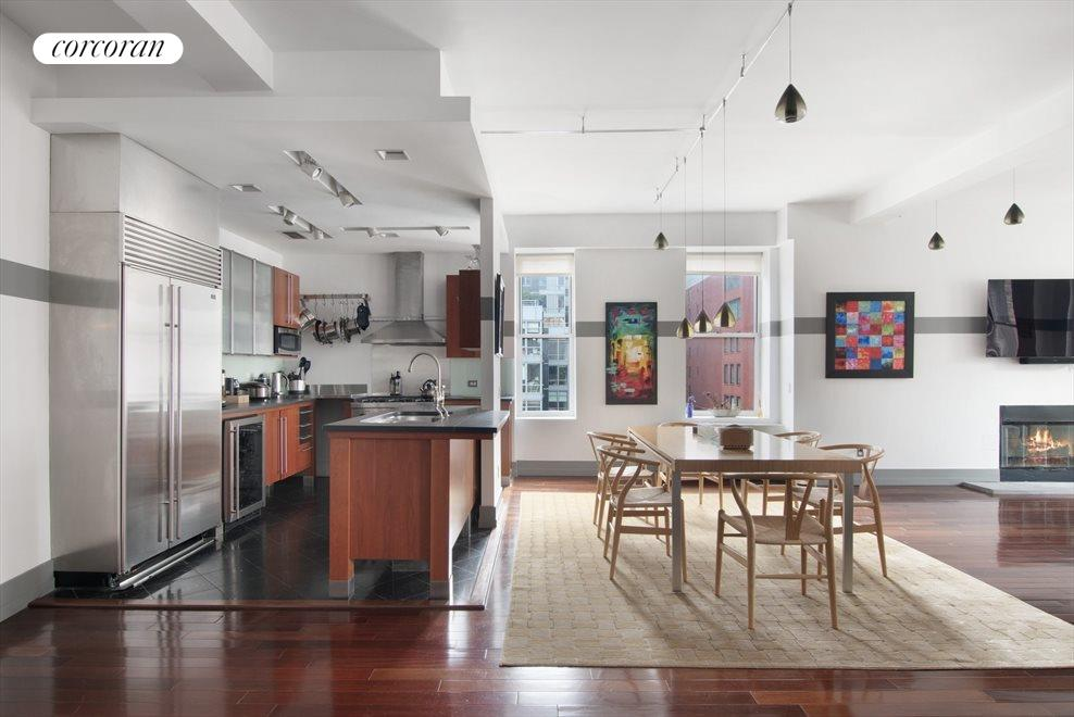 Open kitchen with stainless steel appliances