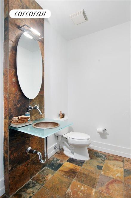 Half bathroom perfect for when you host!