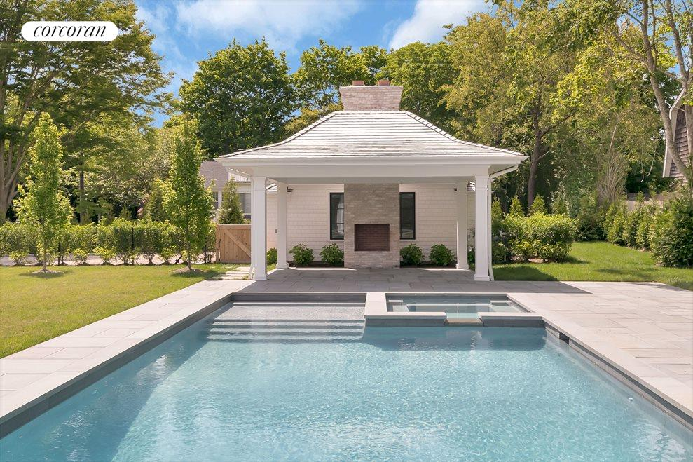 Pool, patio, spa and pavilion with outdoor fireplace
