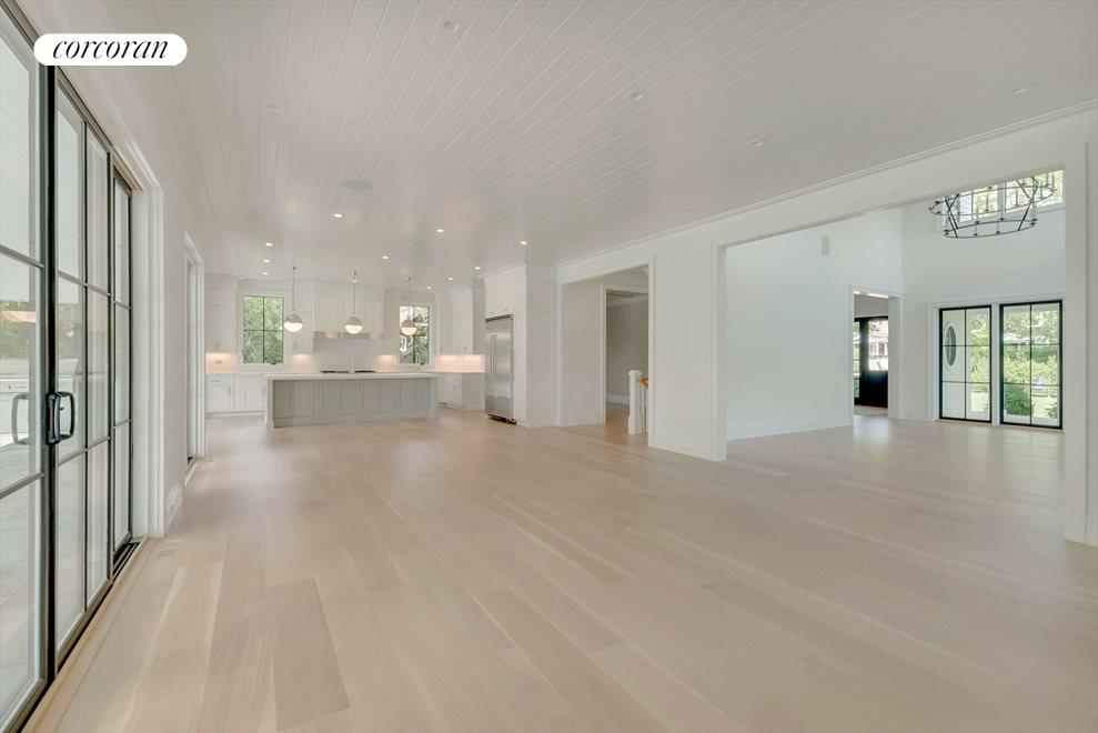 Expansive kitchen,informal dining, seating area opens onto the Great Room