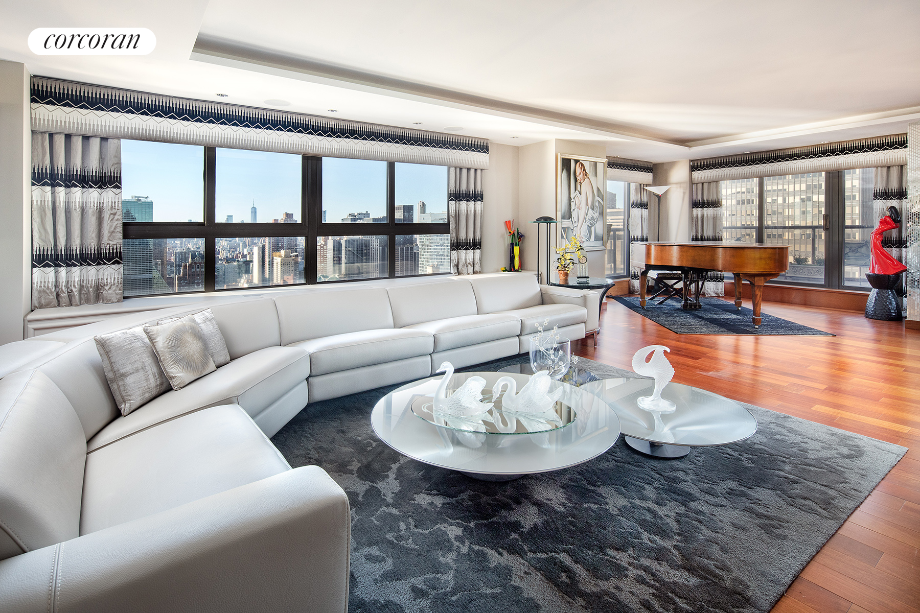 Bask in breathtaking panoramic views from two levels of wrap-around terraces at this rarely available, 50th floor penthouse duplex at 100 United Nations Plaza Condominium.Floating high in the sky in Midtown East's Turtle Bay neighborhood is this exceptional, mint condition 3 bedroom, 3 full and 2 half bathroom penthouse duplex boasting 2 sprawling wrap-around terraces - offering never-ending skyline and river views including such notables as One World Trade, Empire State Building, Chrysler Building, the Queensboro Bridge, East River and so much more. Spanning approximately 3,023 interior square feet and 1,113 of outdoor space, this duplex is ideally configured providing separate living, dining and entertaining areas from the upper floor's three private sleeping quarters.Upon entering the main level is the approximately 55' long gallery with unobstructed views to the west through its floor-to-ceiling windows. To the south, you will find a grand living and entertaining room with a corner exposure and access to the lower level balcony. A tray ceiling with recessed lighting, wet bar and concealed flat screen television complete this expansive space. Occupying the north side of this floor is the corner dining room from which you can also access the balcony to take in a sunny afternoon or glorious evening sunset. The large, windowed kitchen has a pass-through to the dining room for effortless entertaining and features custom cabinetry, granite countertops, marble wall tile and a suite of professional-grade appliances from Viking, Wolf and Sub-Zero, including a pair of dishwashers and full size wine refrigerator. Just beyond the kitchen is a stacked washer and dryer as well as a custom designed, windowed home office (which could also be utilized as a staff room) with an en suite powder room.Ascend to the second floor and you will find a guest powder room, corner master suite and two more bedrooms, each with its own en suite windowed bathroom. The private master suite enjoy