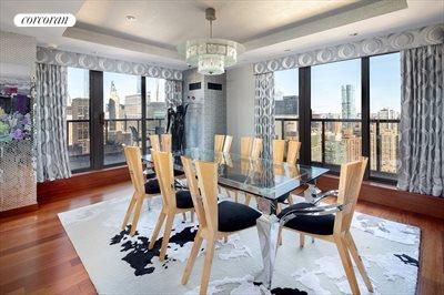 New York City Real Estate | View 100 United Nations Plaza, #50B | Corner dining room with access to wrap terrace