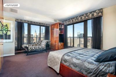 New York City Real Estate | View 100 United Nations Plaza, #50B | Corner master bedroom with en suite bathroom