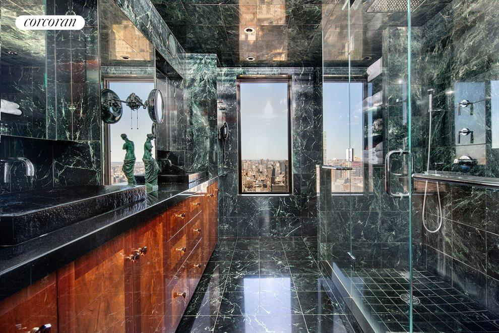 New York City Real Estate | View 100 United Nations Plaza, #50B | One of a kind windowed marble master bathroom