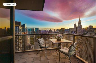 New York City Real Estate | View 100 United Nations Plaza, #50B | Stunning sunset from wrap terrace