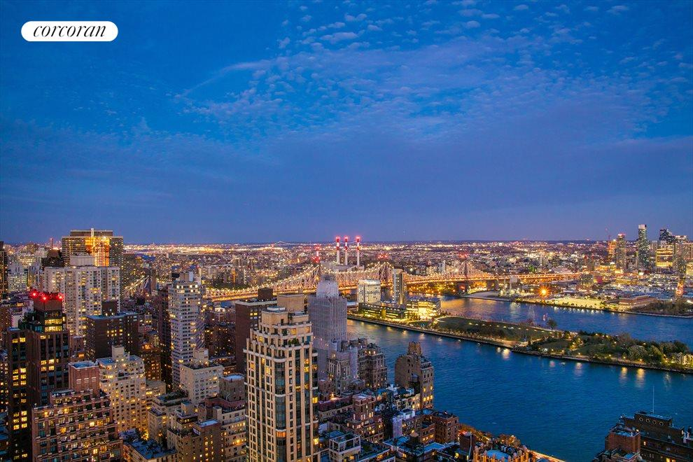 New York City Real Estate | View 100 United Nations Plaza, #50B | Radiant East River evening views