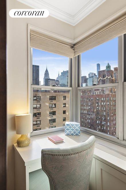 Corner Window with Built In Desk in Bedroom