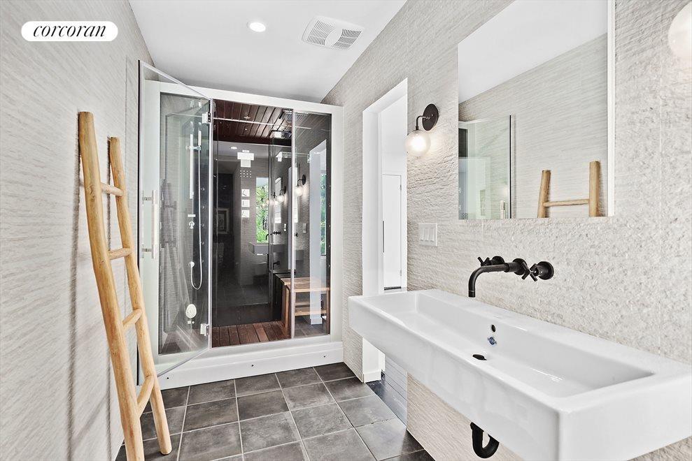 First Floor Master Bath with Steam Shower, Rain Head and Multi-Spray Jets.  Built-in Stereo too!