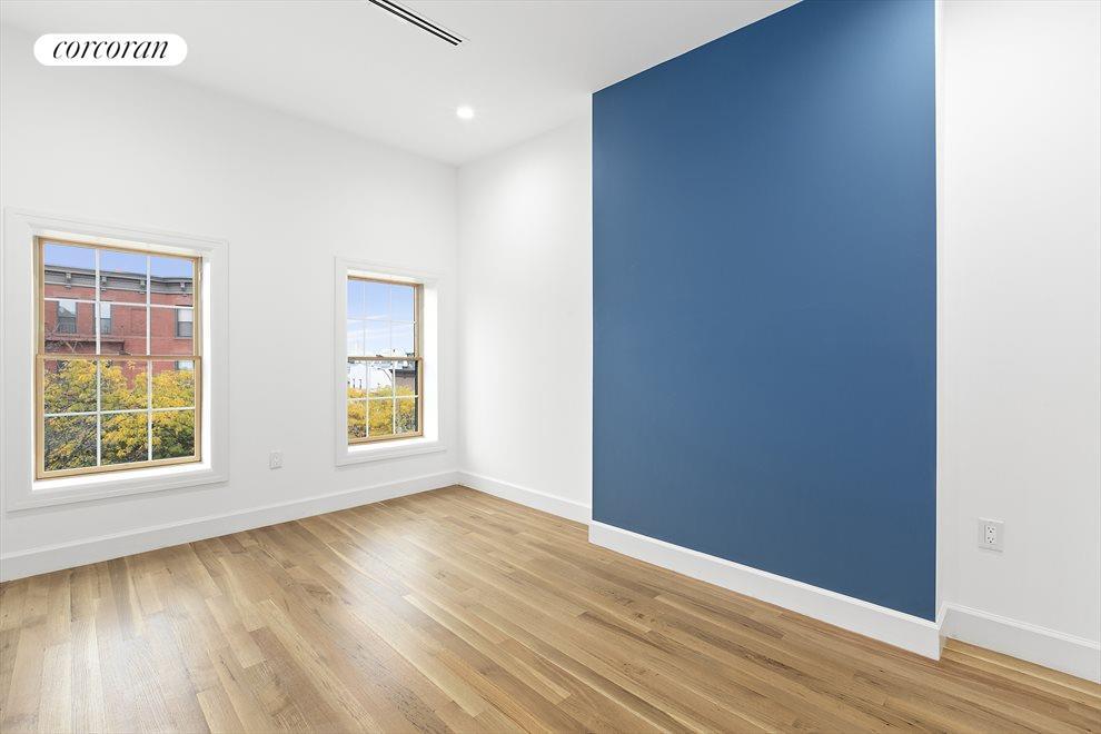 Tasteful accent walls and hardwood floors!