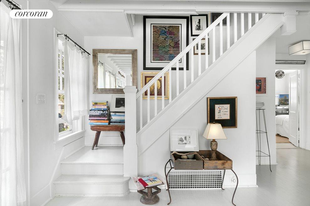 Staircase from living room to master bedroom suite