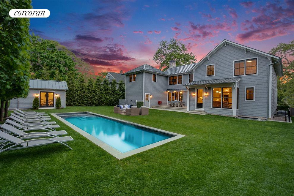Beautiful yard with pool and pool house