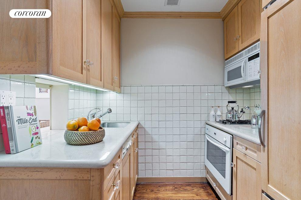 New York City Real Estate | View 470 West 24th Street, #16J | Kitchen has pass-thru to living room