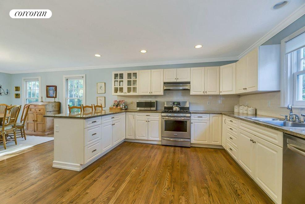 LARGE KITCHEN WITH TONS OF COUNTER SPACE.