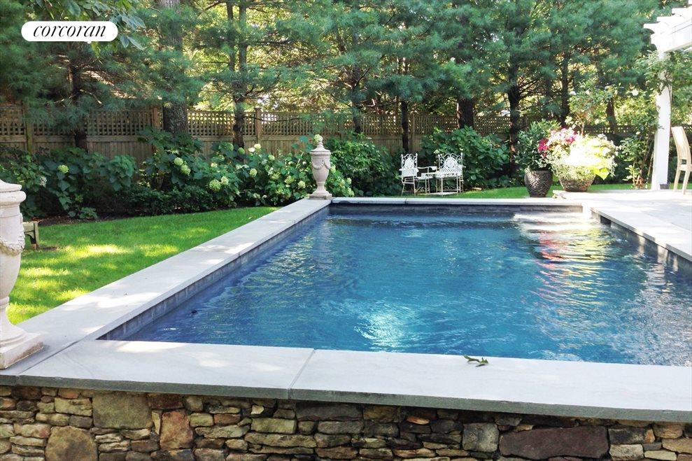 GUNITE POOL SURROUNDED BY ENGLISH STYLE GARDENS