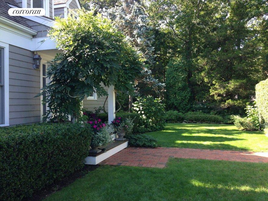 STORYBOOK FRONT YARD WITH LUSH LANDSCAPING