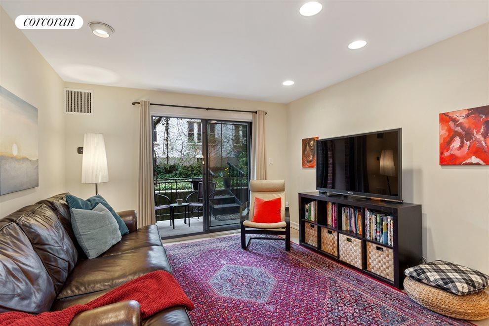 Spacious living room with backyard views