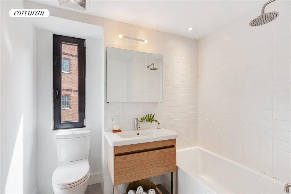 Crisp, windowed hall bathroom