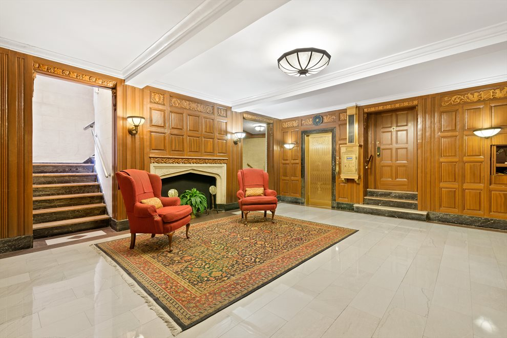 Wood paneled lobby with 24 hour doorman service.