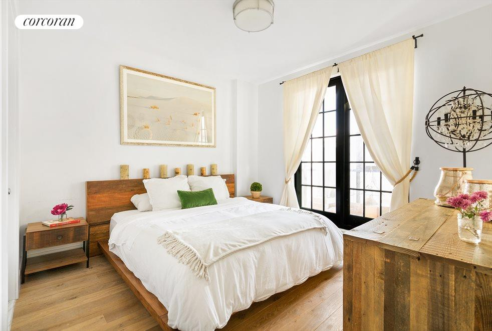 Master bedroom with balcony & en-suite bathroom