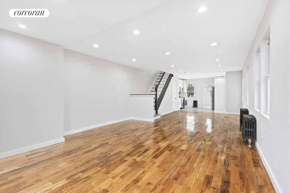 New York City Real Estate | View 69-24 66th Place | Elegant stairwell leading to bedrooms!