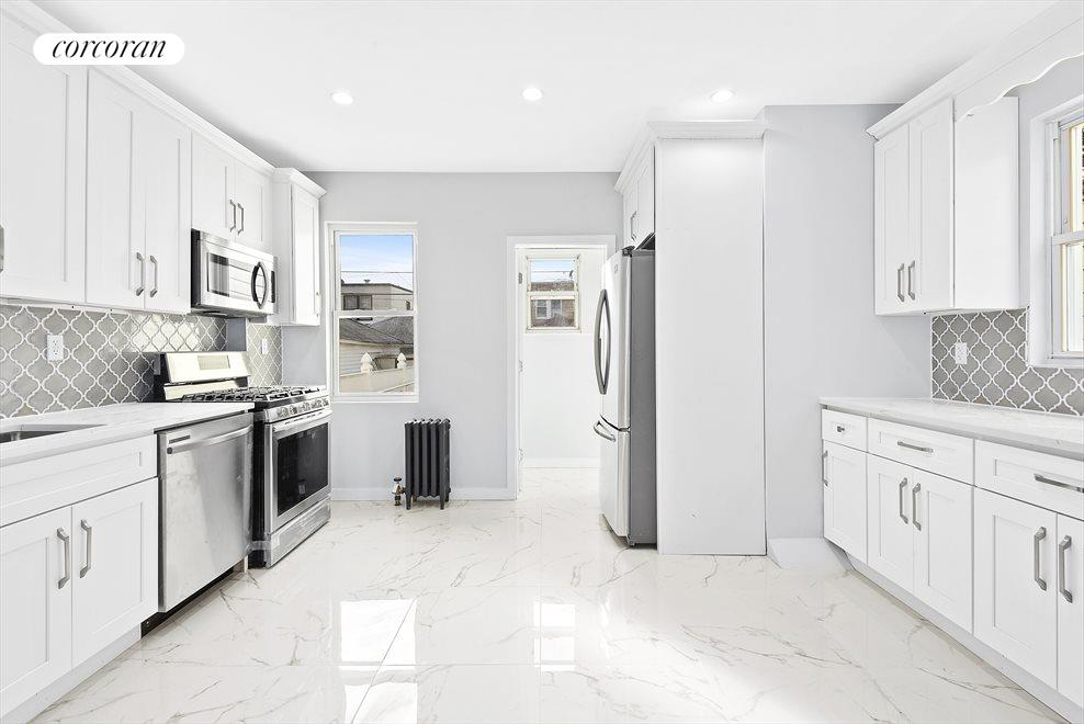 New York City Real Estate | View 69-24 66th Place | Gigantic windowed kitchen!