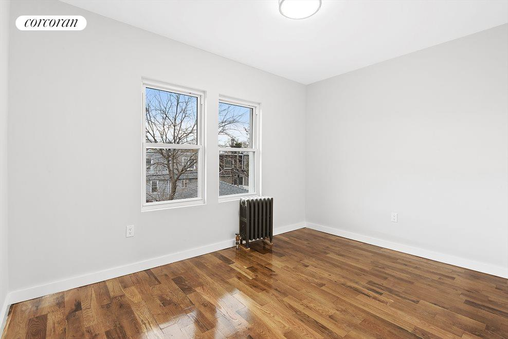 New York City Real Estate | View 69-24 66th Place | Large bedrooms with tons of light!