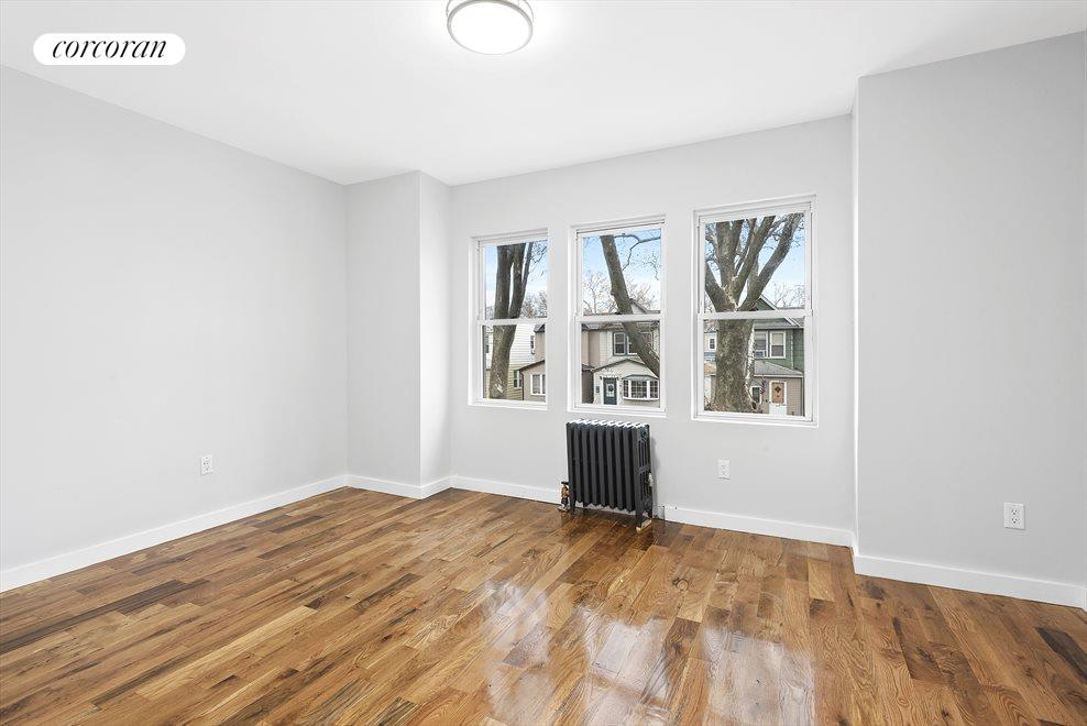 New York City Real Estate | View 69-24 66th Place | Stunning hardwood floors throughout!